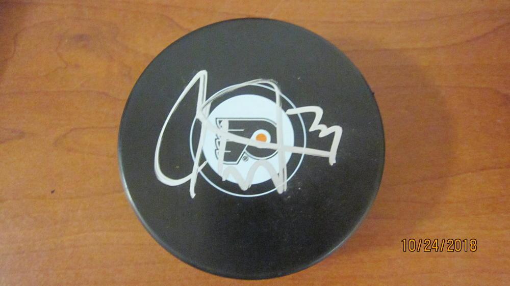 Carter Hart Philadelphia Flyers Signed Logo Puck COA